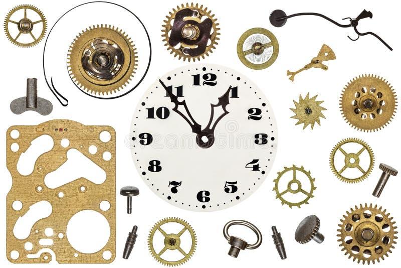 Spare parts for clock. Metal gears, cogwheels and other details. Spare parts for clock. Metal gears, cogwheels, clock face and other details stock photography