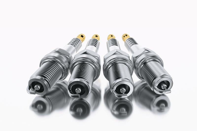 Spare parts spark plugs on white background for car and motorcycle stock photos