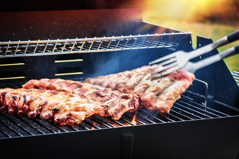 Spare ribs cooking on barbecue grill for summer outdoor party. F stock photos