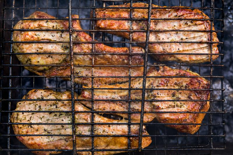 Spare ribs cooking on barbecue grill for summer outdoor party. royalty free stock photos