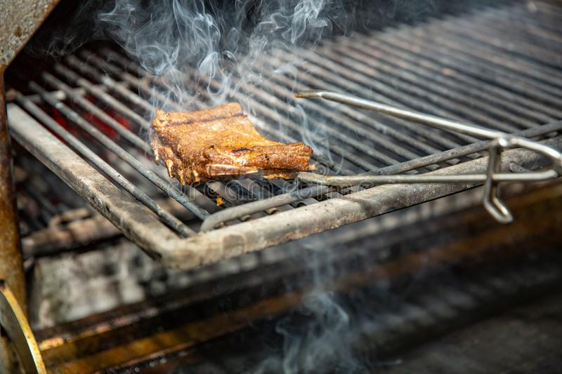 Spare ribs cooking on barbecue grill for summer outdoor party. stock images