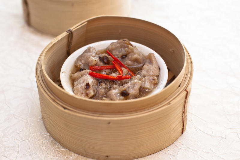 Spare ribs Dumpling. Dim sum spare ribs are known to be cooked in different styles, mostly in steamed cart paired with fermented black beans and chilli stock photography