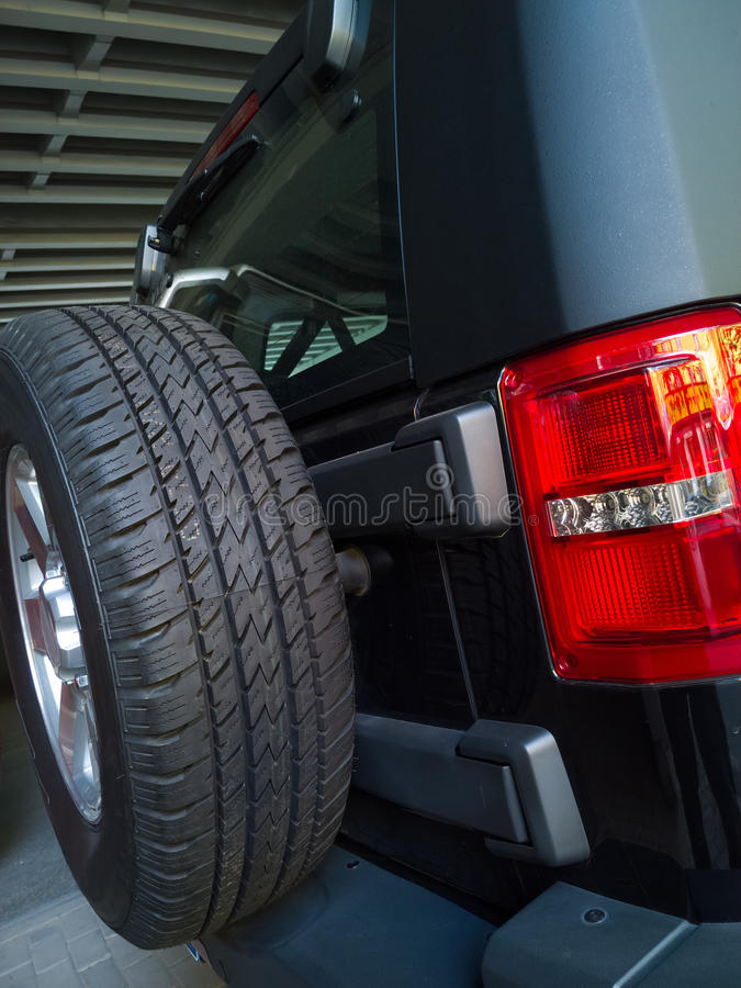 Spare tire. On the back door of a suv car stock photography