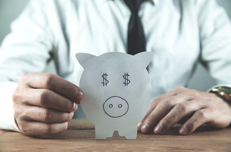 Spargris för papper för visning för affärsman Begrepp av besparingen och Inv royaltyfri foto