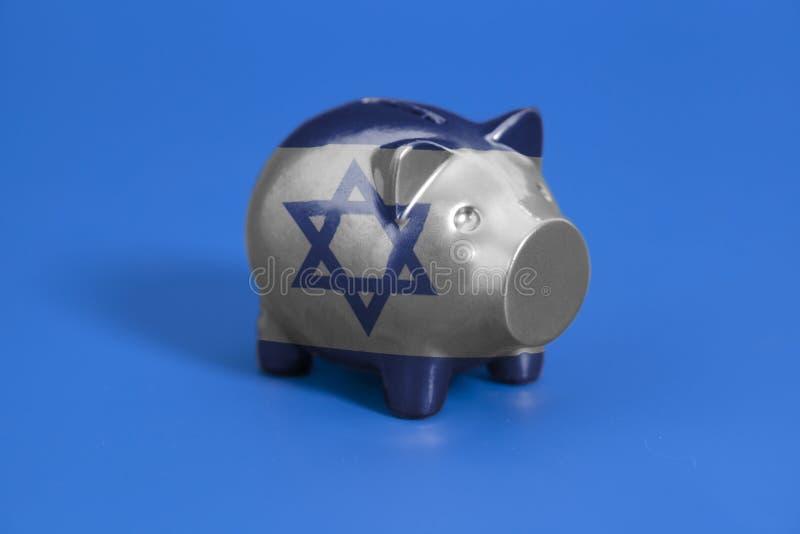 Spargris med flaggan av Israel arkivbild