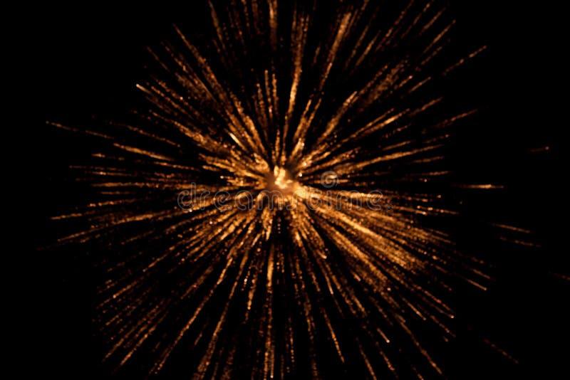 Spark, blast background. Blurred orange and yellow background of a fire spark or blast. Dark background stock photo