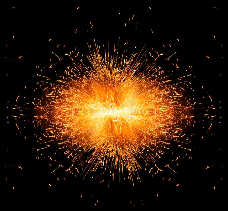 Spark burst!. Burst of spark on black background stock photos