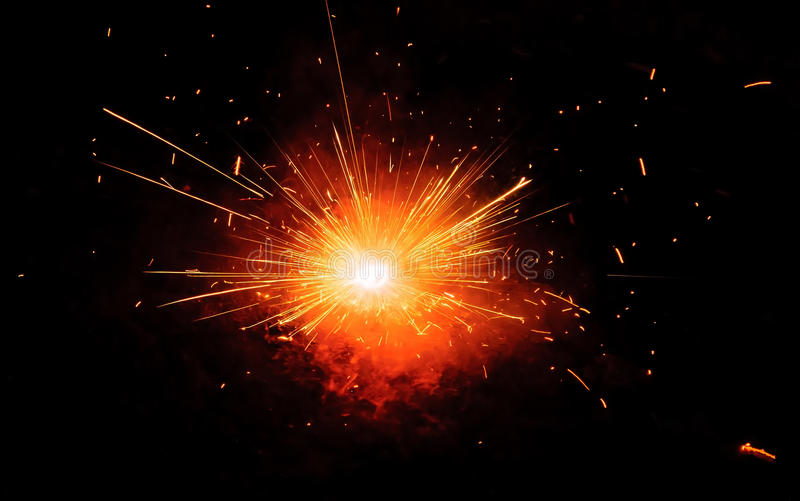 Spark burst!. Burst of spark on black background royalty free stock images