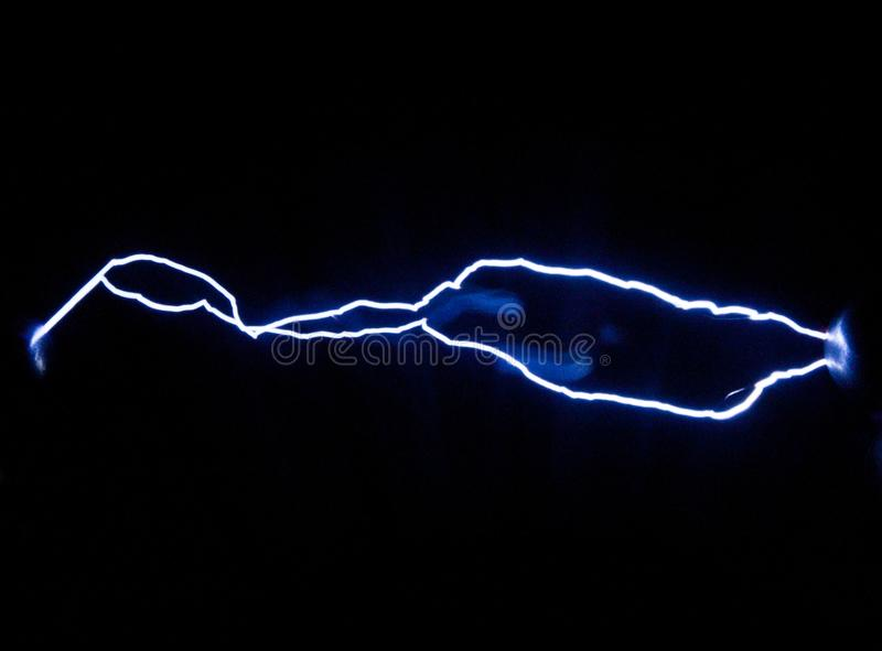 Two of spark electric discharges obtained with the help of an electrophoresis machine royalty free stock image