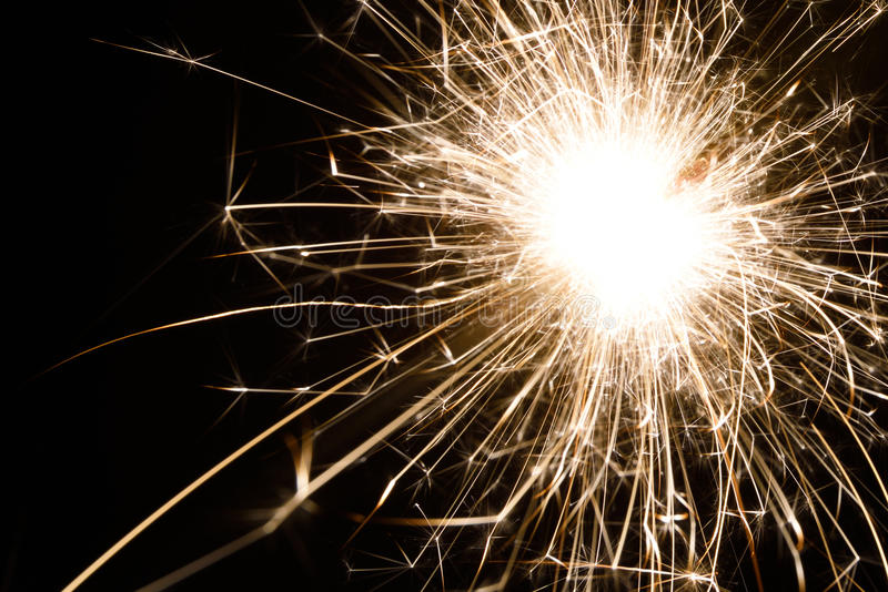 Spark. An isolated spark from a sparkler stock images