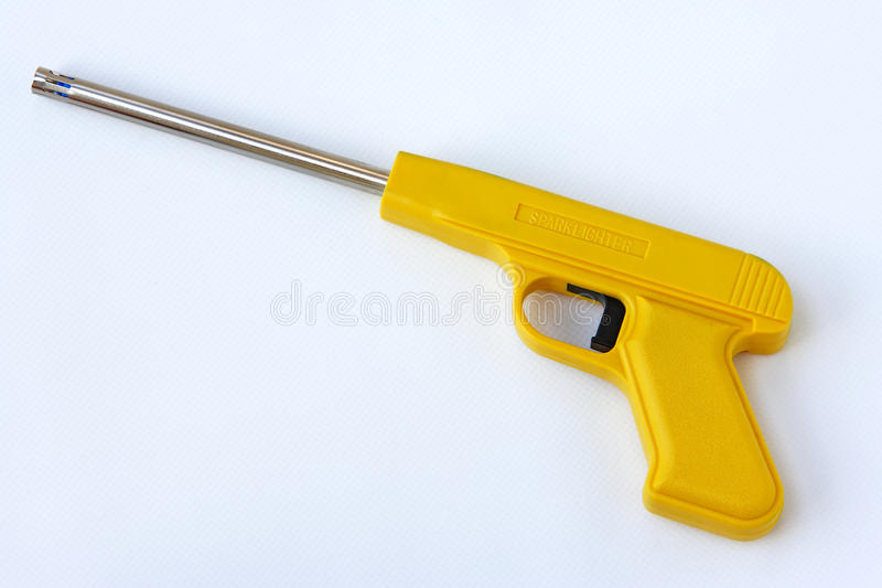 Spark lighter. A yellow spark lighter on a white back stock photo