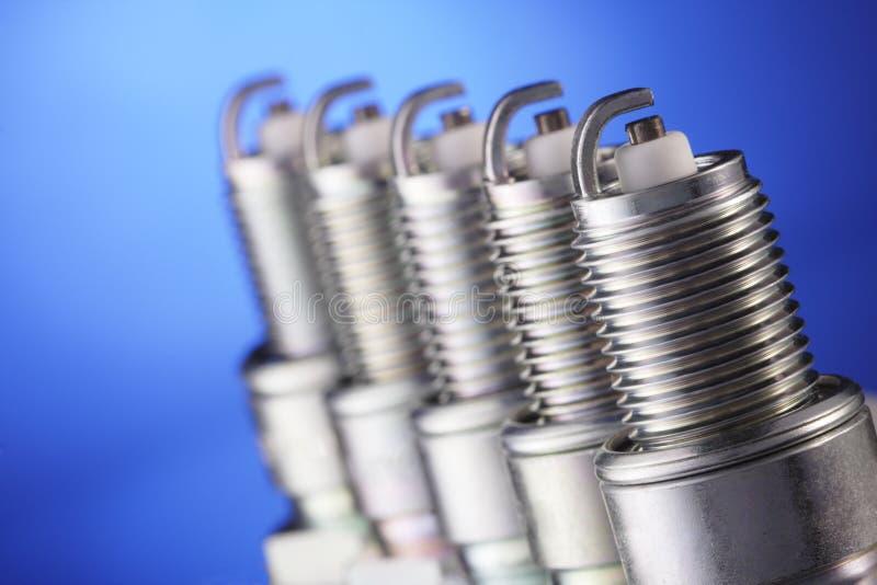 Spark plug. On blue background stock image
