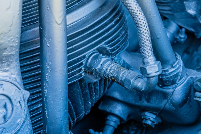 Spark plug in piston. Of radial engine that has been painted silver royalty free stock images