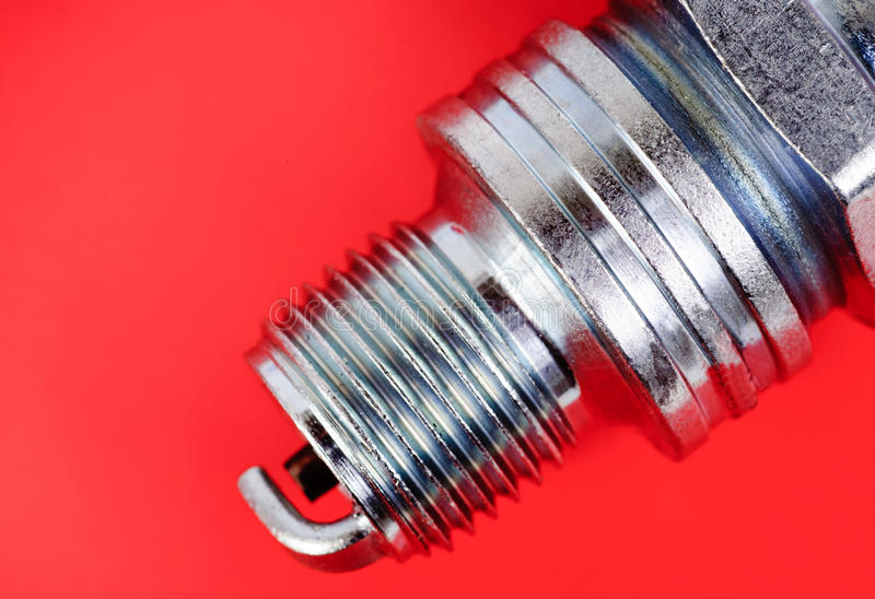 Download Spark-plug on the red stock photo. Image of macro, parts - 22079296
