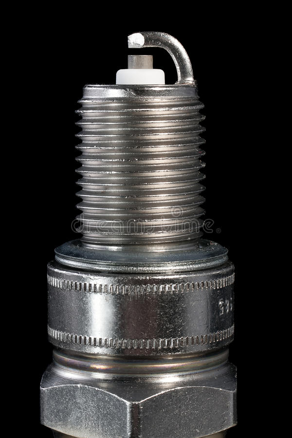 Spark plugs. One spark plug on a black background stock photo