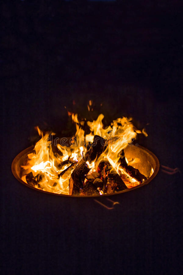 Sparking camp fire in dark stock photography