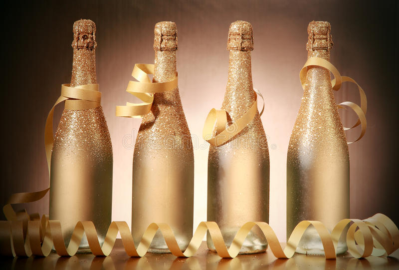 Sparking Golden Brown Christmas Bottles with Laces stock image