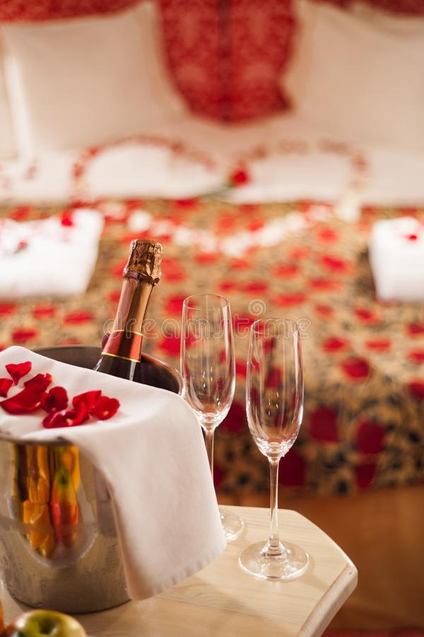 Sparking wine, champagne glasses and rose petals royalty free stock photos