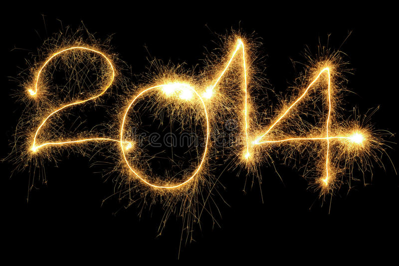 Sparking 2014 Year. New Year 2014 formed from sparking digits over black background stock photo
