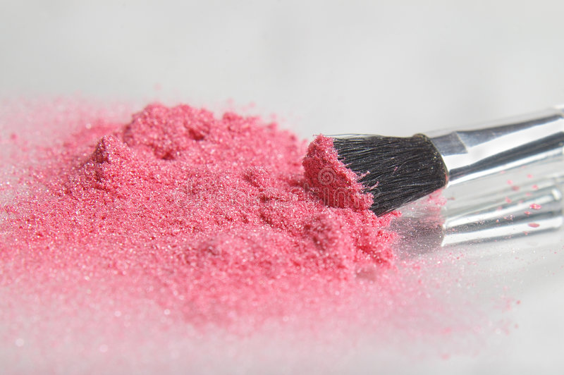 Sparkle. Pink sparkle eye shadow powder with an applicator brush stock images