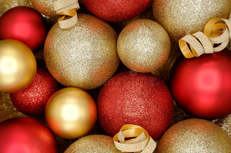 Sparkle red and gold Christmas ornaments background. Festive holiday concept stock images