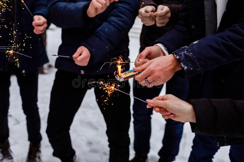 People burn Bengal lights. Sparkler background. Christmas and new year sparkler holiday background royalty free stock photography