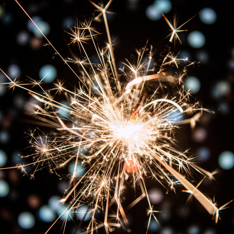 Sparkler with bokeh background stock image