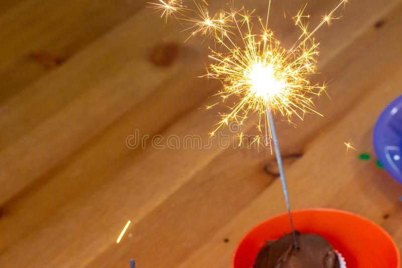 A Sparkler on a Chocolate Cupcake stock photos
