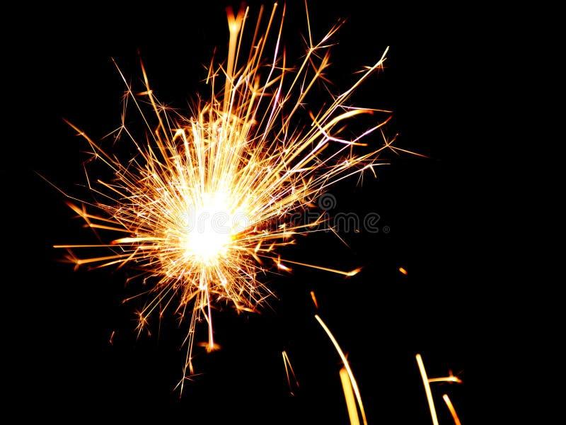 Sparkler - Christmas Stock photos. Sparkler on black night background - Christmas firework royalty free stock photo