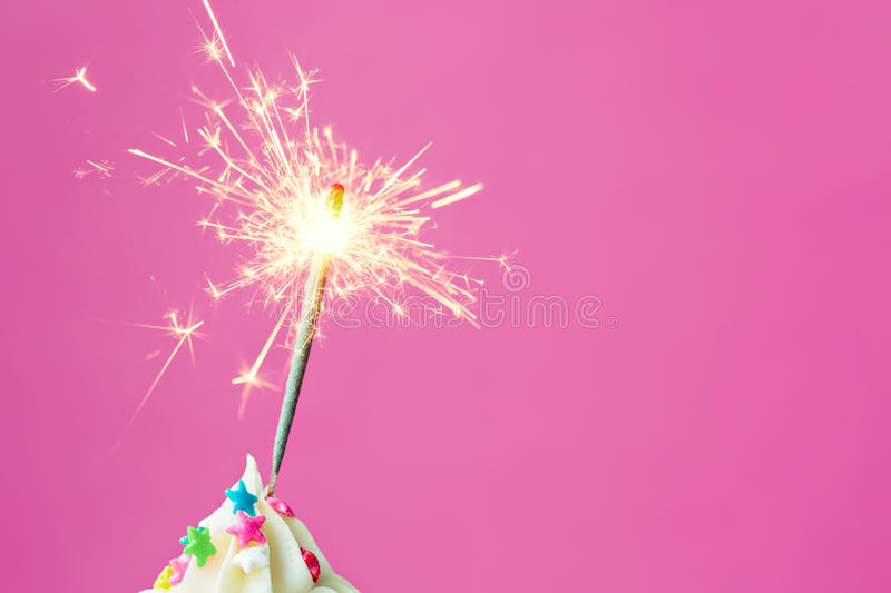 Sparkler on a cupcake royalty free stock photography