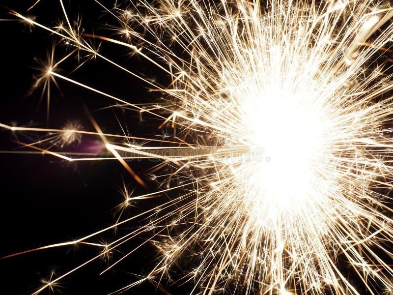 Sparkler on a dark background stock images