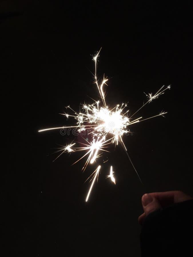Sparkler in the dark. Girl holding a sparkler in the dark stock photography