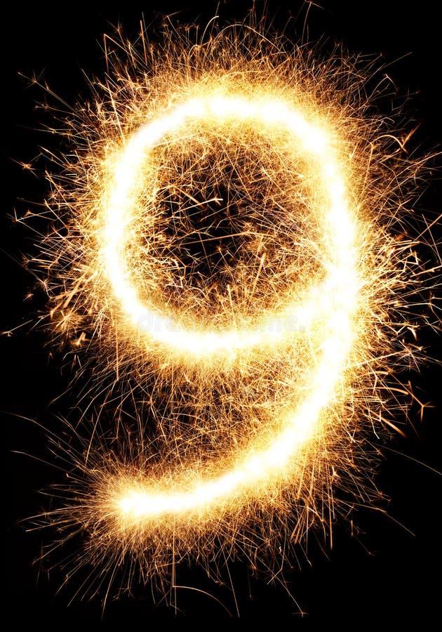 Sparkler fajerwerku światło liczba 9 odizolowywająca na czerni obrazy royalty free