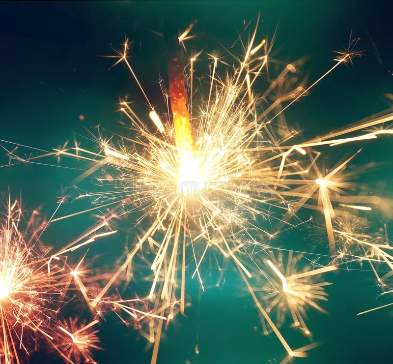 Sparkler fire. New year celebration background royalty free stock images