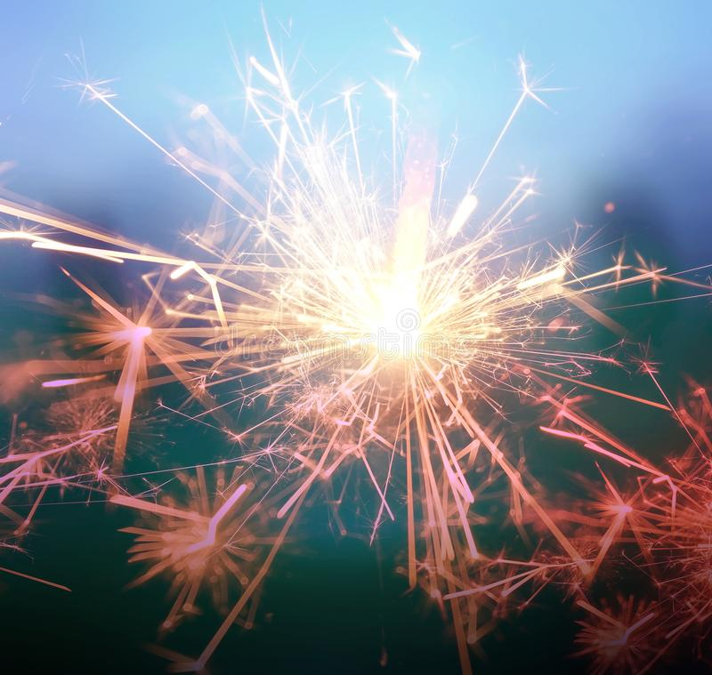 Sparkler fire with retro color tone background. stock image