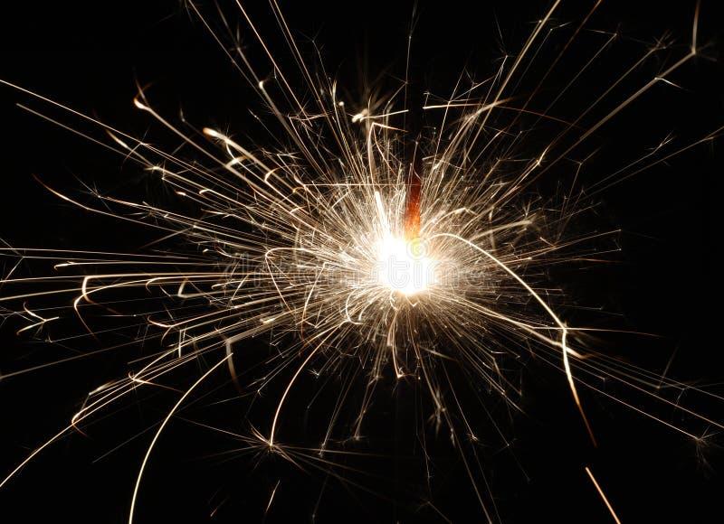 Sparkler Firework. A single lit sparkler firework sending off sparks royalty free stock image