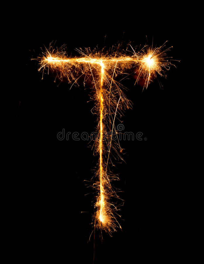 Sparkler firework light alphabet T (Capital Letters) at night. Background royalty free stock photography