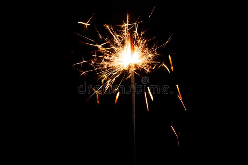 Sparkler forming beautiful of star shape. Darkness is all around and effect of sparkling is amazing stock photo