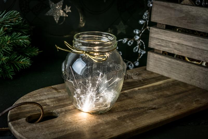 Sparkler in glas jar stock photos
