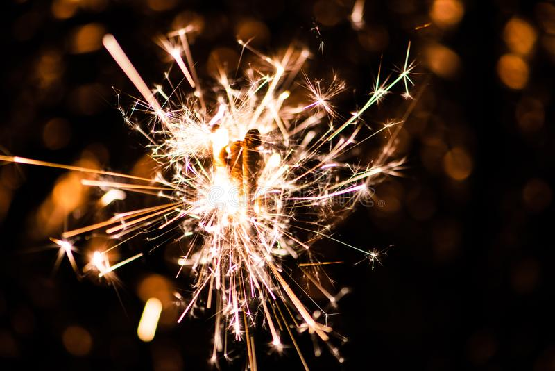 Sparkler glowing in the dark. Abstract, art, background, beam, beautiful, bengal, black, blue, bright, burn, celebrate, celebration, christmas, closeup royalty free stock images