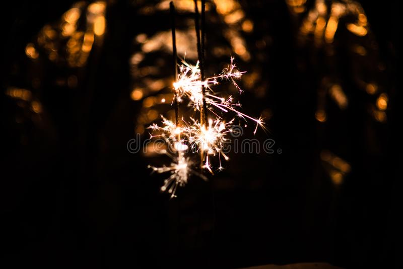 Sparkler glowing in the dark. Abstract, art, background, beam, beautiful, bengal, black, blue, bright, burn, celebrate, celebration, christmas, closeup stock photo