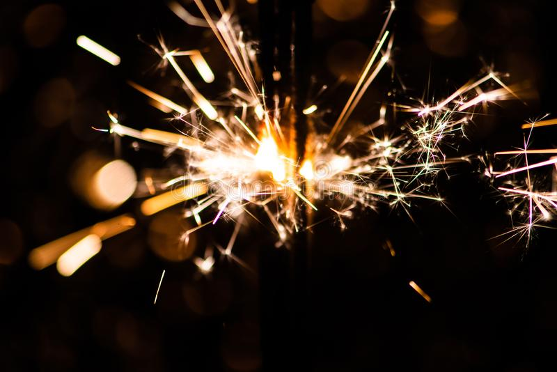 Sparkler glowing in the dark. Abstract, art, background, beam, beautiful, bengal, black, blue, bright, burn, celebrate, celebration, christmas, closeup stock photos