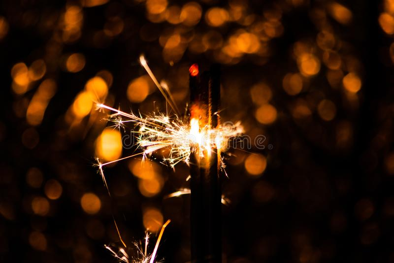 Sparkler glowing in the dark. Abstract, art, background, beam, beautiful, bengal, black, blue, bright, burn, celebrate, celebration, christmas, closeup royalty free stock photo
