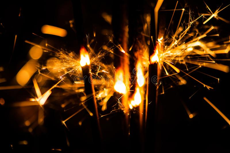 Sparkler glowing in the dark. Abstract, art, background, beam, beautiful, bengal, black, blue, bright, burn, celebrate, celebration, christmas, closeup royalty free stock photography