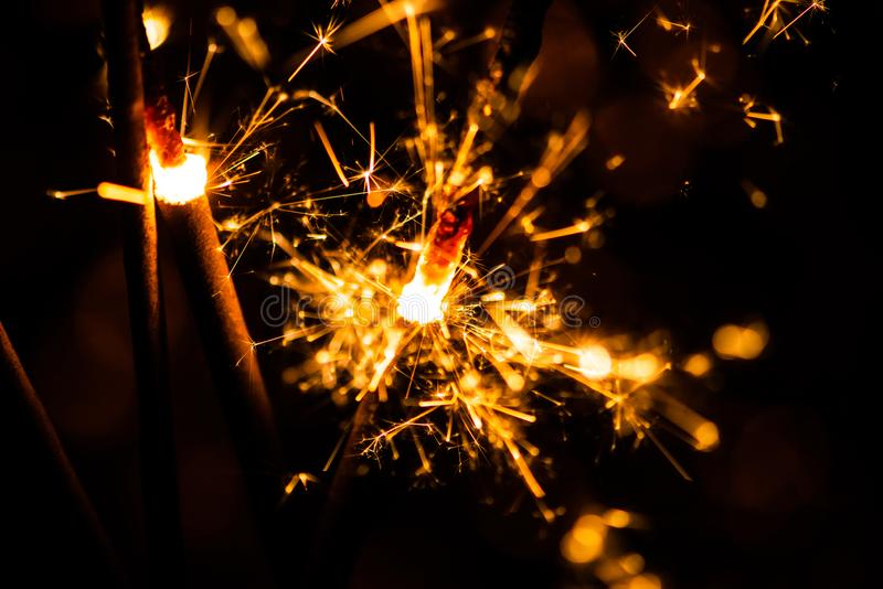 Sparkler glowing in the dark. Abstract, art, background, beam, beautiful, bengal, black, blue, bright, burn, celebrate, celebration, christmas, closeup stock image