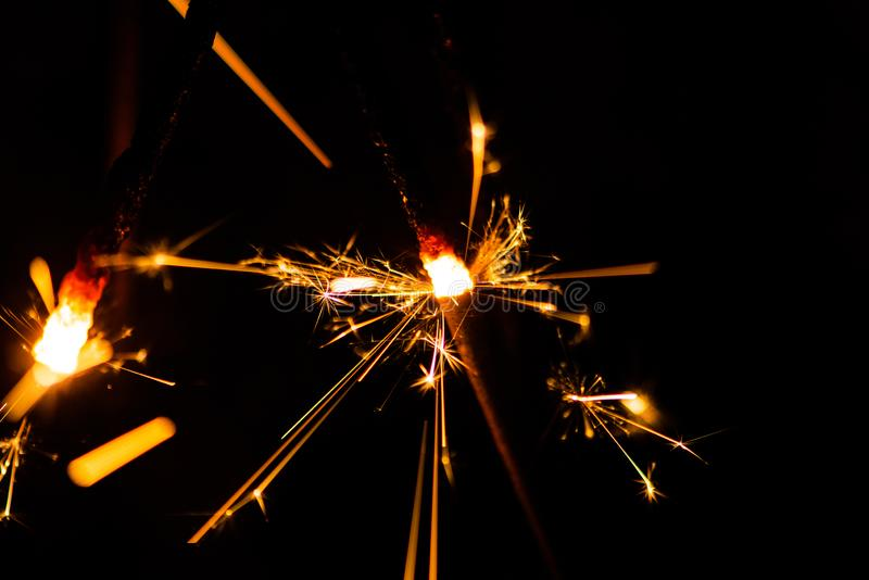 Sparkler glowing in the dark. Abstract, art, background, beam, beautiful, bengal, black, blue, bright, burn, celebrate, celebration, christmas, closeup stock photography
