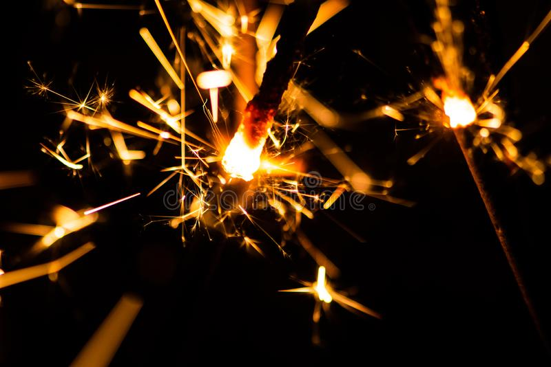Sparkler glowing in the dark. Abstract, art, background, beam, beautiful, bengal, black, blue, bright, burn, celebrate, celebration, christmas, closeup stock images