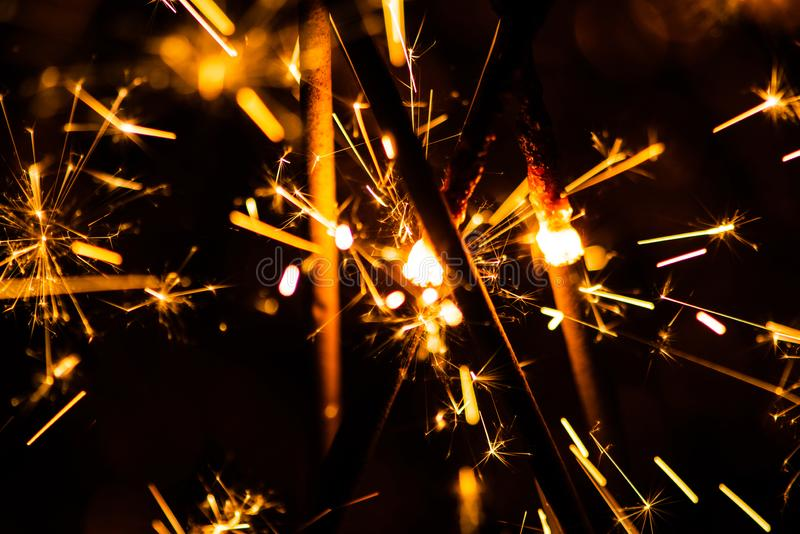 Sparkler glowing in the dark. Abstract, art, background, beam, beautiful, bengal, black, blue, bright, burn, celebrate, celebration, christmas, closeup royalty free stock image