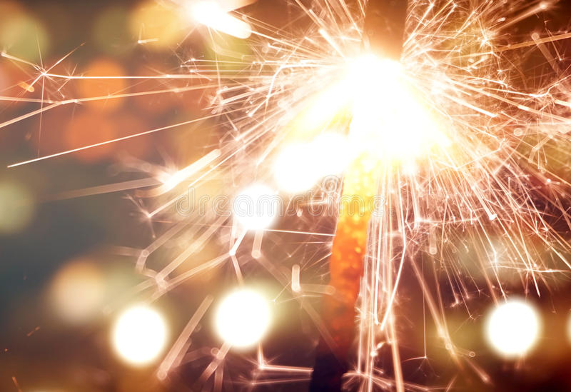 Sparkler on gold bokeh background macro close up stock photography