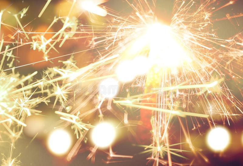 Sparkler on gold bokeh background macro close up. stock photography